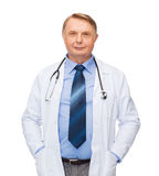 Smiling doctor or professor with stethoscope stock image