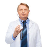Smiling doctor or professor with stethoscope Royalty Free Stock Photo