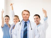 Smiling doctor or professor with stethoscope Royalty Free Stock Photos