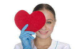 Smiling doctor right eye covered with heart symbol Stock Photo