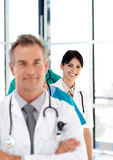 Smiling doctor in a row. Attractive smiling doctor in a row Royalty Free Stock Photography