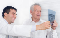 Smiling doctor and senior patient Stock Images
