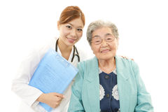 Smiling doctor and senior woman Stock Images