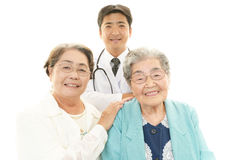 Smiling doctor and senior women Royalty Free Stock Image
