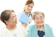 Smiling doctor with senior women Stock Images