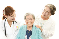 Smiling doctor with senior women Stock Photos