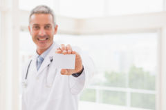 Smiling doctor showing a blank royalty free stock images