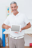 Smiling doctor showing laptop pc Royalty Free Stock Photo