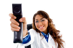 Smiling Doctor Showing Phone Receiver Royalty Free Stock Photos