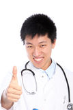 Smiling doctor showing thumb up Stock Photos