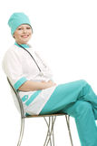 Smiling doctor sitting on chair Stock Image