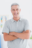 Smiling doctor standing arms crossed and looking at camera Royalty Free Stock Photo