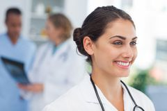 Smiling doctor standing in front of a medical team Stock Images
