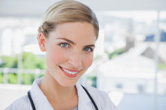 Smiling doctor standing in her office Royalty Free Stock Photography