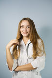 Smiling doctor with stethoscope Royalty Free Stock Photography