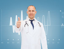 Smiling doctor with stethoscope showing thumbs up Stock Photo