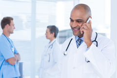 Smiling doctor talking on the phone Royalty Free Stock Photo