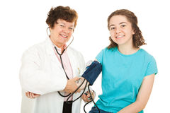 Smiling Doctor and Teen Patient Stock Photos