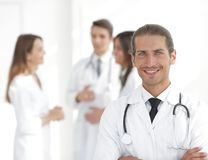 Smiling doctor therapist on blurred background. Royalty Free Stock Image