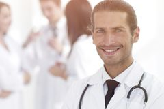 Smiling doctor therapist on blurred background. royalty free stock photos