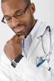 Smiling doctor thinking Royalty Free Stock Photos
