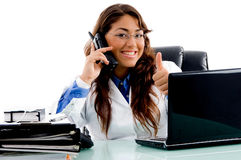 Smiling doctor with thumbs up. In an office Royalty Free Stock Photos