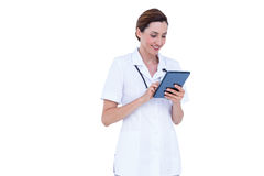 Smiling doctor using tablet Stock Photos