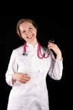 Smiling doctor in a white dressing gown Stock Image