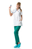 Smiling Doctor in white medical gown ,showing stetoscope Royalty Free Stock Photos