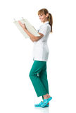 Smiling Doctor in white medical gown writing Royalty Free Stock Photography