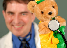 Smiling Doctor With Puppet, Shallow DOF Royalty Free Stock Images