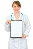 Smiling doctor woman holding blank clipboard Stock Photos