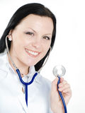 Smiling doctor woman holding stethoscope Stock Photo