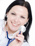 Smiling doctor woman holding stethoscope Stock Photos