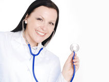 Smiling doctor woman holding stethoscope Royalty Free Stock Image