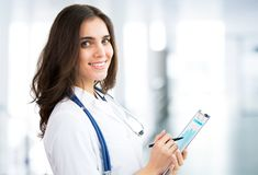 Smiling doctor woman royalty free stock image
