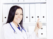 Smiling doctor woman with stethoscope in office Royalty Free Stock Images