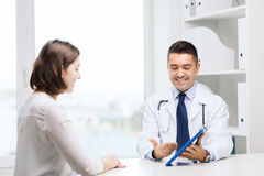 Smiling doctor and woman with tablet pc at clinic Royalty Free Stock Photography