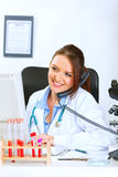 Smiling doctor woman talking on phone Royalty Free Stock Photos