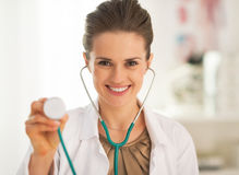 Smiling doctor woman using stethoscope Royalty Free Stock Images
