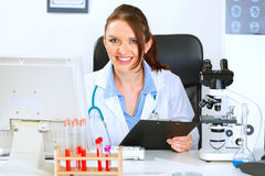 Smiling doctor woman working in office. Smiling medical doctor woman working in office Royalty Free Stock Photo