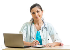 Smiling doctor working at laptop isolated Royalty Free Stock Images