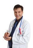 Smiling Doctor with writing pen and pad Stock Image