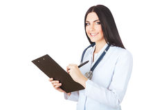 Smiling doctor writing to folder Royalty Free Stock Photography