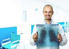 Smiling doctor with xray Royalty Free Stock Photography