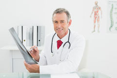 Smiling doctor with xray picture of lungs in office Stock Photos