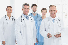 Smiling doctors all standing together Royalty Free Stock Photography
