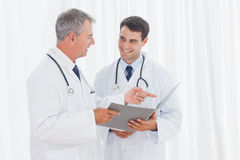 Smiling doctors analyzing results together Royalty Free Stock Photography