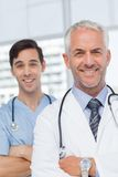 Smiling doctors with arms crossed Royalty Free Stock Photos