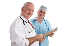 Smiling Doctors with Chart Stock Images